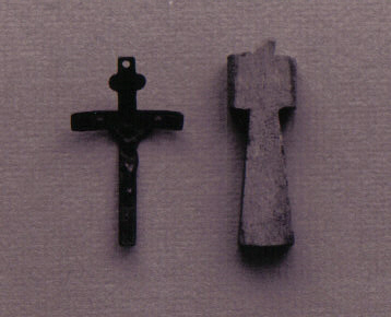 A metal crucifix and bone cross excavated from the Warden's Residence.
