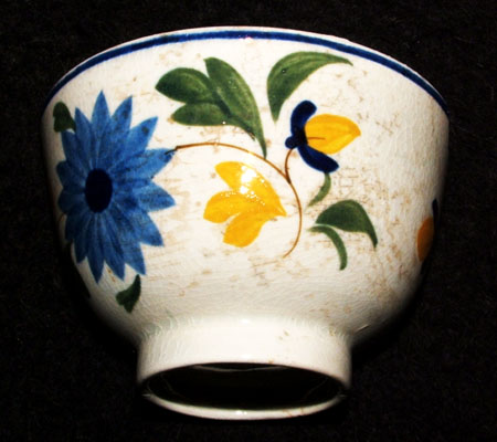 Hand painted pearlware demitasse excavated from the Brant property.