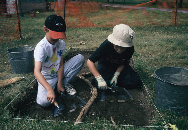 """Can You Dig It?""© participants excavating at the site of the Garrison Hospital."