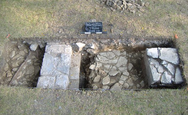 This excavation unit shows the western wall and a stone support pier for a hallway or staircase of cottage number 1 that was built in 1822.