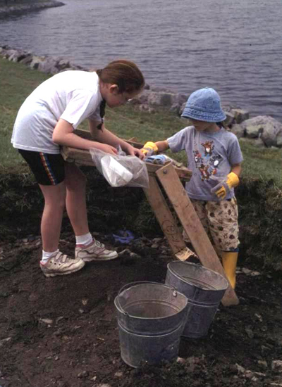 """Can You Dig It?""© participants excavating at the naval cottages in 1998."