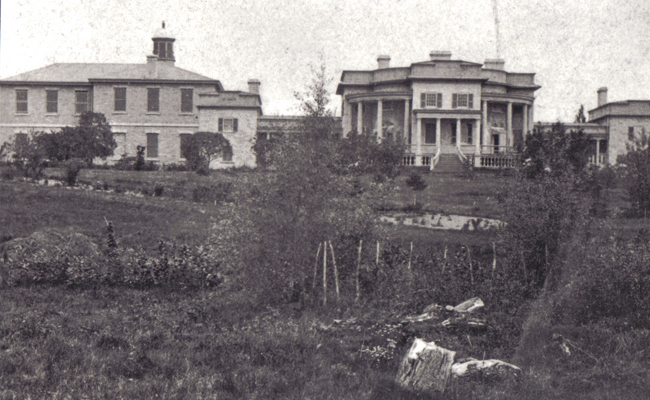 Photograph of Summerhill (with original Colonnades and parapets) at Queen's University - showing old medical building (1858 - with original fenestration) on the left-hand side